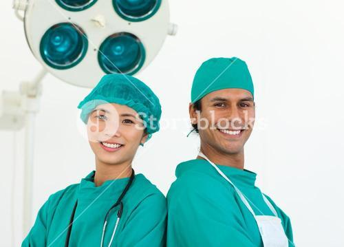 Close up of two surgeons