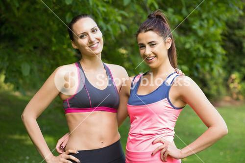 Two fit friends posing
