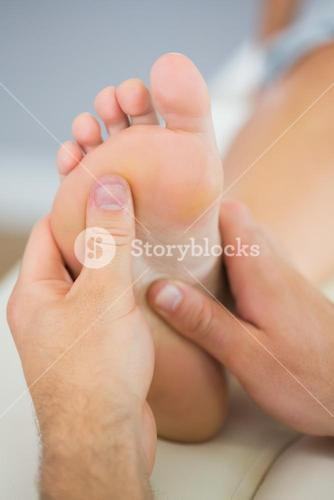 Picture of foot massage treatment from physiotherapist