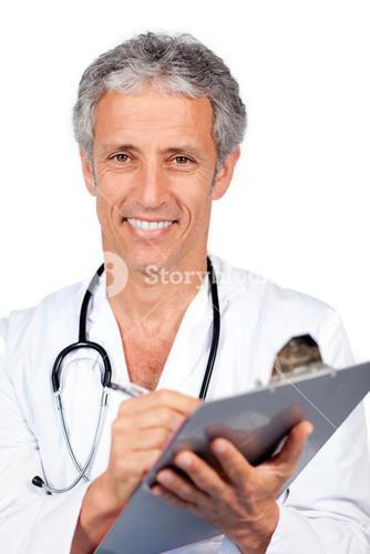 Smiling doctor writting documents