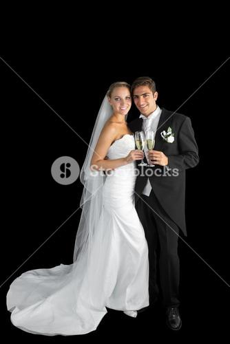 Content young couple posing holding champagne glasses