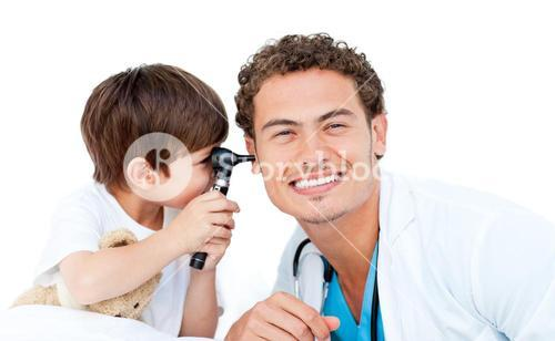 Little boy playing with the surgeon