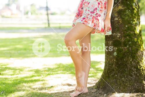 Picture of womans leg in floral dress