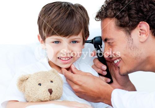 Attractive doctor examining patients ears