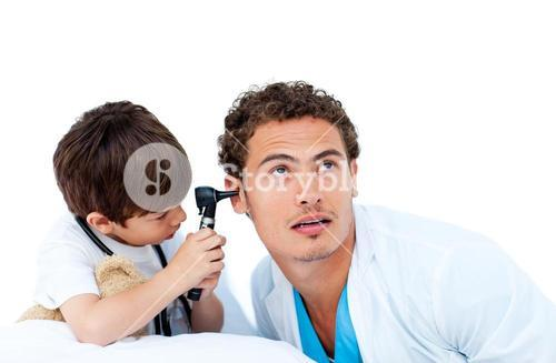 Young boy playing with the surgeon