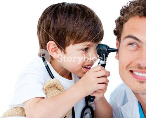 Cute boy playing with the doctor