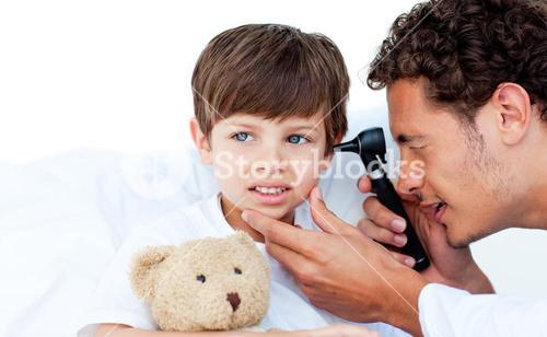 Concentrated doctor examining patients ears