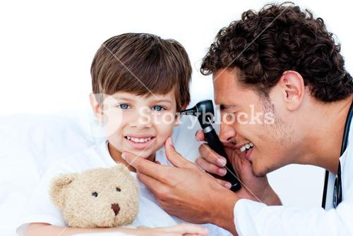 Smiling doctor examining patients ears