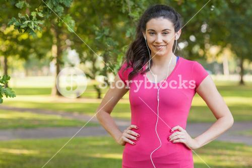 Content young woman posing in a park