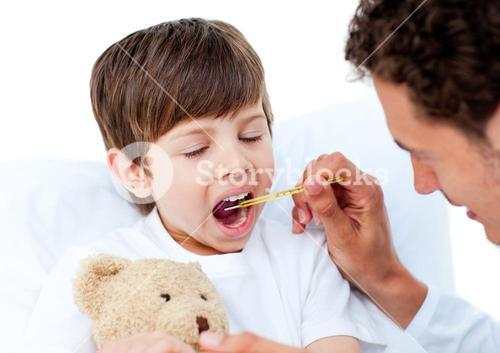 Doctor taking little boys temperature
