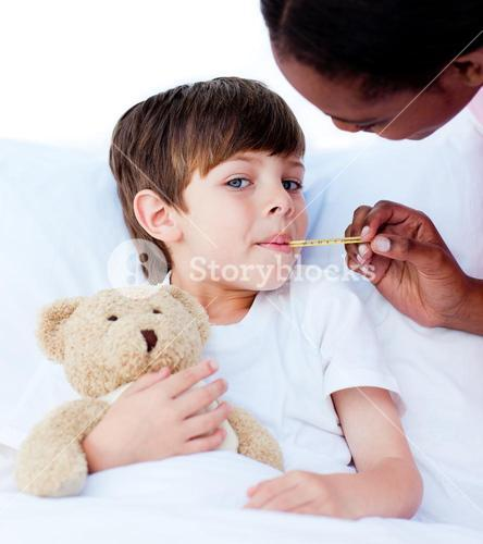 Serious nurse taking childs temperature
