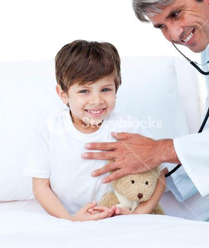 Smiling little boy attending a medical checkup