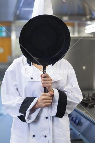 Chef covering face with pan