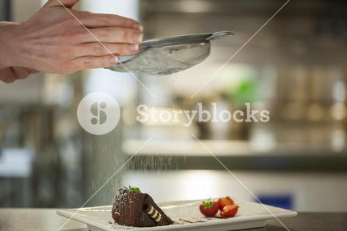Chef finishing a dessert plate