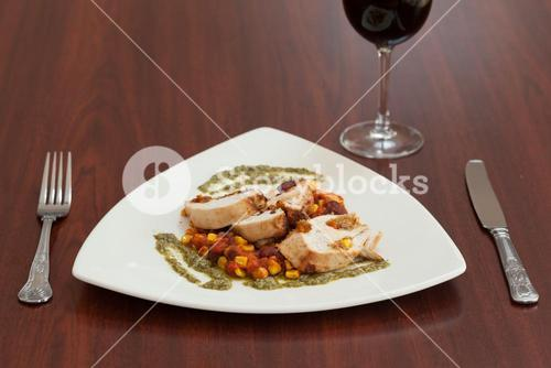 High angle view of delicious chicken dish with salsa