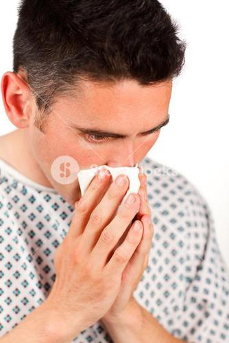 Close up of a patient sneezing
