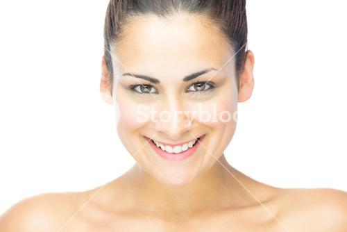 Front view of beautiful brunette woman smiling at camera