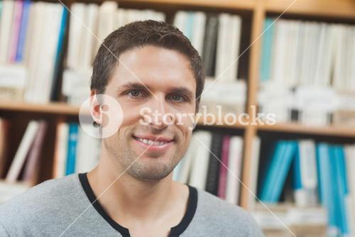 Handsome man posing in library