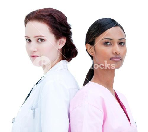 Portrait of charismatic nurse and doctor standing