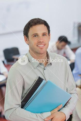 Handsome male teacher posing in his classroom