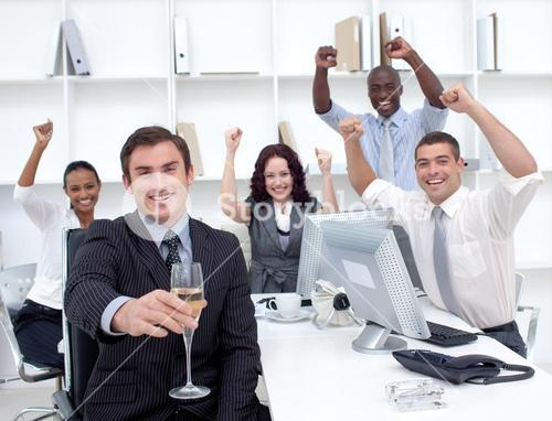 Successful Business team driking champagne in office