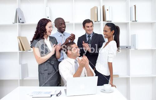 Business team applauding a female collegue for her ideas