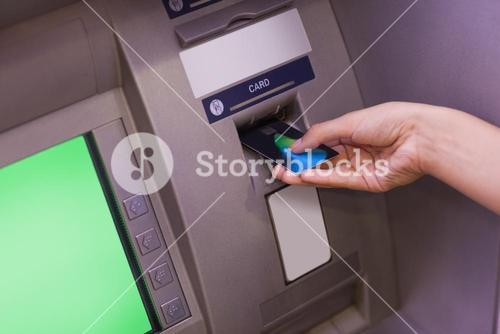 Close up of hand withdrawing cash