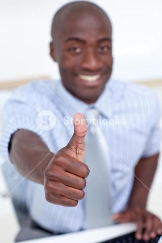High angle of a businessman in office with thumb up