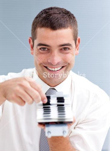 Attractive businessman consulting a directory
