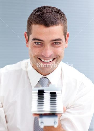 Attractive businessman consulting a businesscard holder