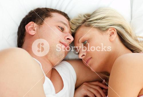 Intimate couple relaxing in bed