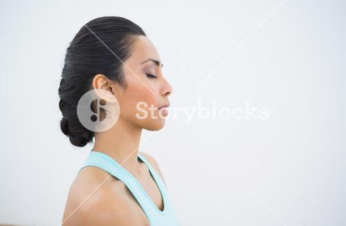 Beautiful sporty relaxed woman meditating