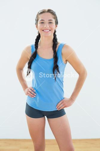Smiling woman in sportswear and plaits