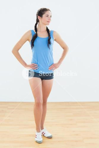 Thoughtful woman in sportswear looking away