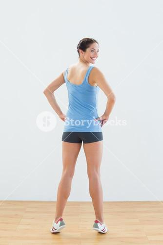 Rear view portrait of a smiling woman tip toeing