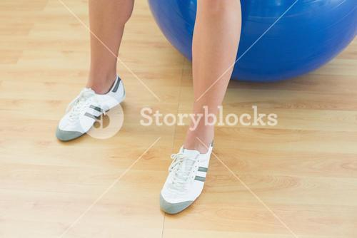Womans legs and exercise ball