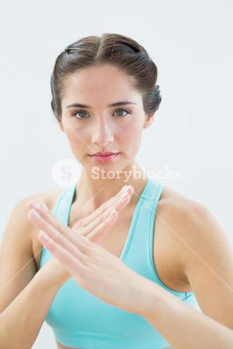 Close up portrait of a fit woman in defending posture