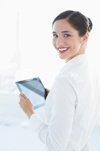 Smiling business woman with tablet PC in office