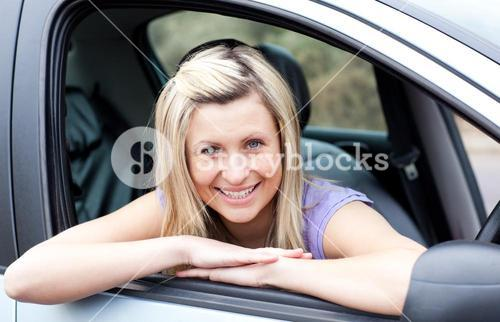 Portrait of a happy young female driver
