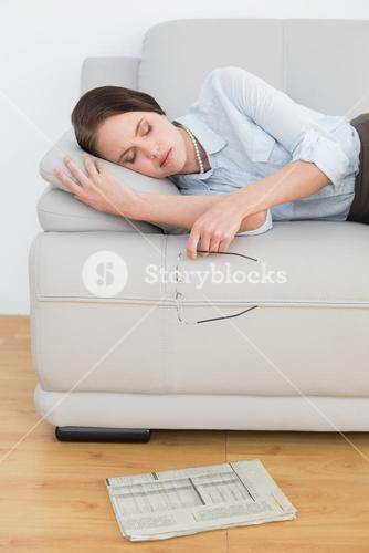 Well dressed woman sleeping on sofa