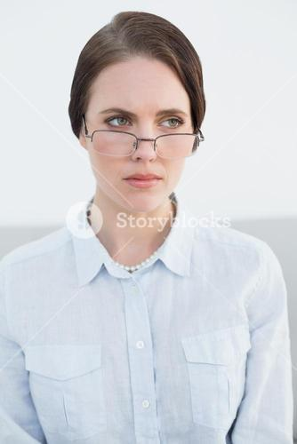 Displeased young woman wearing eye glasses