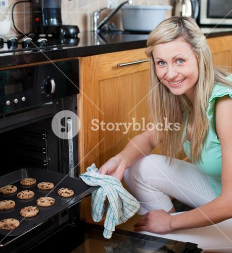Happy woman baking cookies