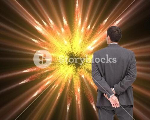 Businessman standing with hands behind back