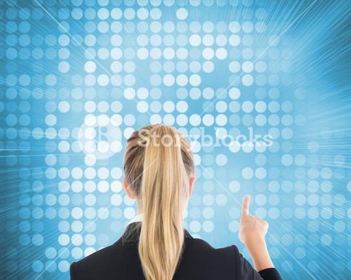 Blonde business woman pointing somewhere