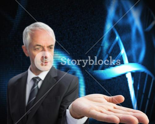 Concentrated businessman with palm up presenting holographic dna spiral
