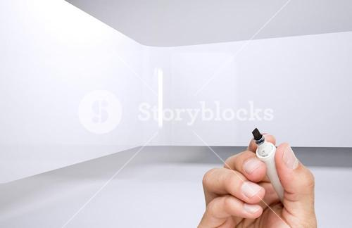 Hand holding a marker