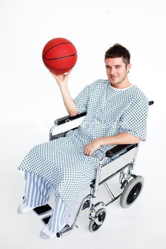 Patient in wheelchair holding a basket ball