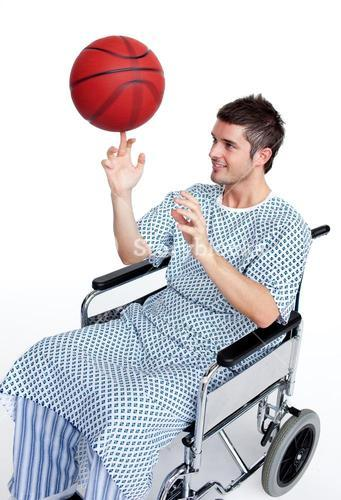 Hansdome patient in wheelchair having fun with a basket ball