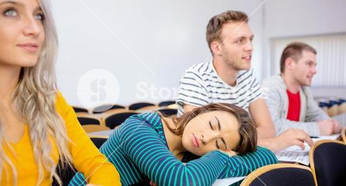 Female sleeping in the college classroom