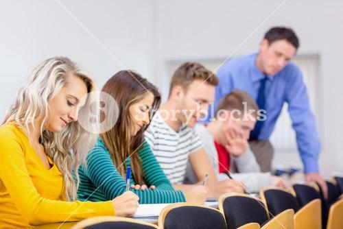 Teacher with college students in the classroom